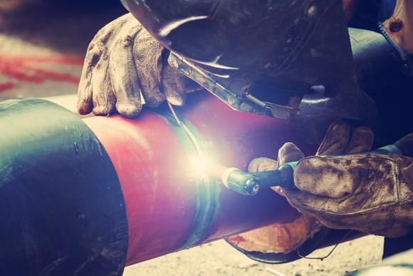 A welder working on a pipeline.