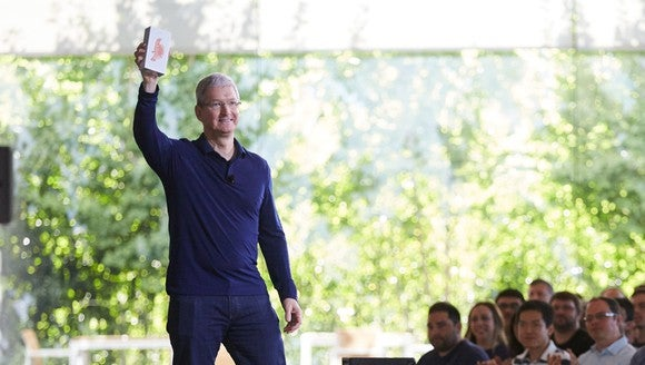 Tim Cook holding up the billionth iPhone in front of Apple employees