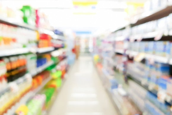 A blurry image of a supermarket aisle