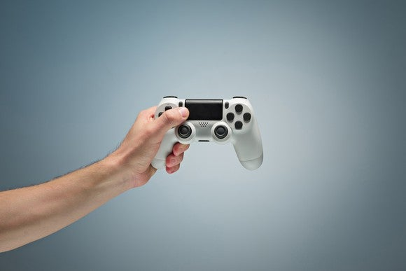 Person holding a gaming controller.
