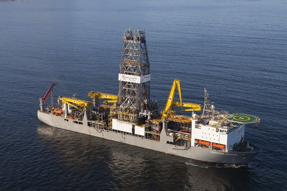 Drilling rig ship at sea with Transocean logo.