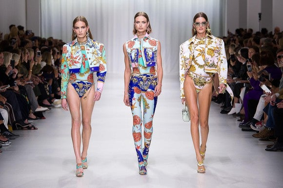Versace models on a runway