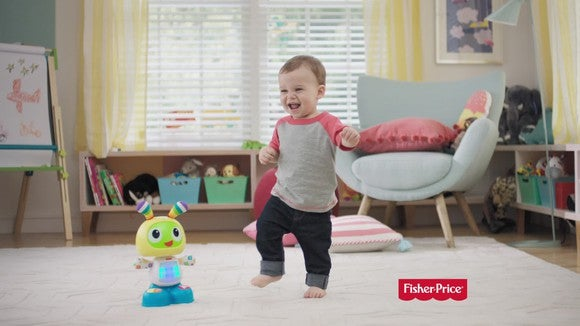 A child and a Fischer Price toy playing in a den.