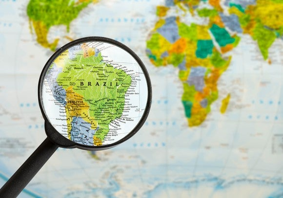 Magnifying glass over map of Brazil.