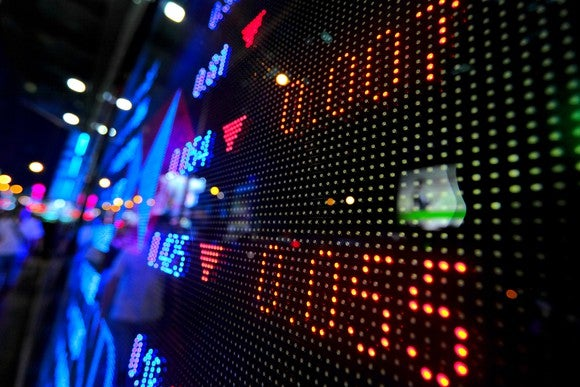 Blurry shot of a stock price index on an electronic board.