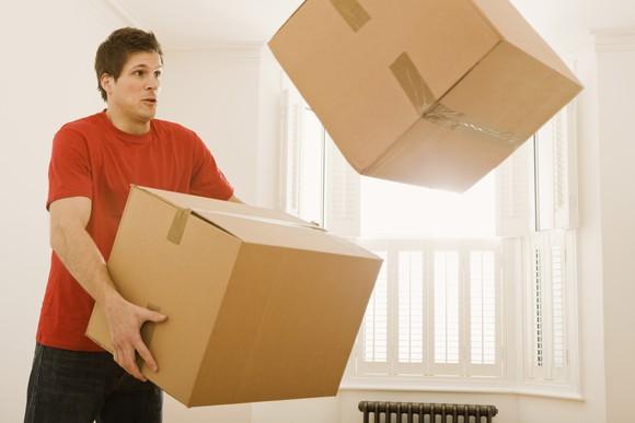 Man dropping boxes