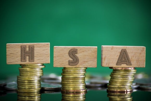 Piles of coins with letter-blocks spelling out HSA.