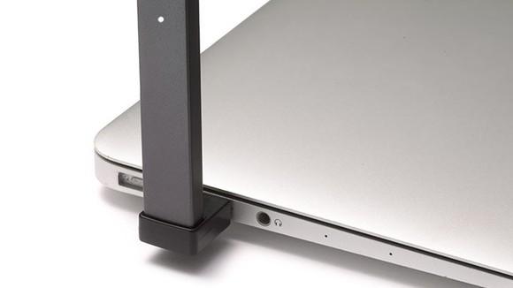 A JUUL e-cig plugged into a laptop