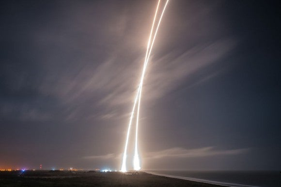 Time lapse photo showing rocket trails rising and descending