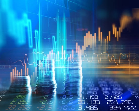 Rising stock graph with piles of coins and columns of numbers.