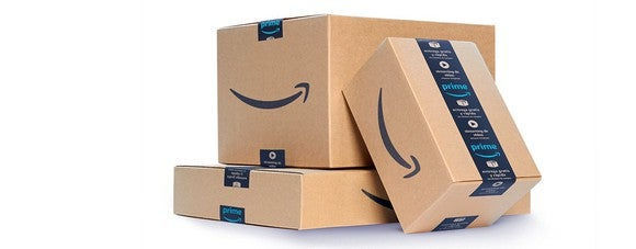 A stack of boxes with the Amazon logo on them.