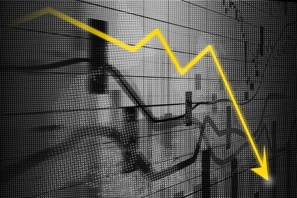 Stock market chart in black and white with a yellow arrow indicating losses