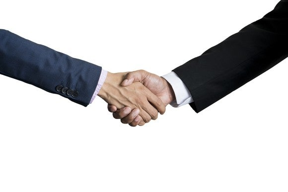 Two businessmen's hands shaking.