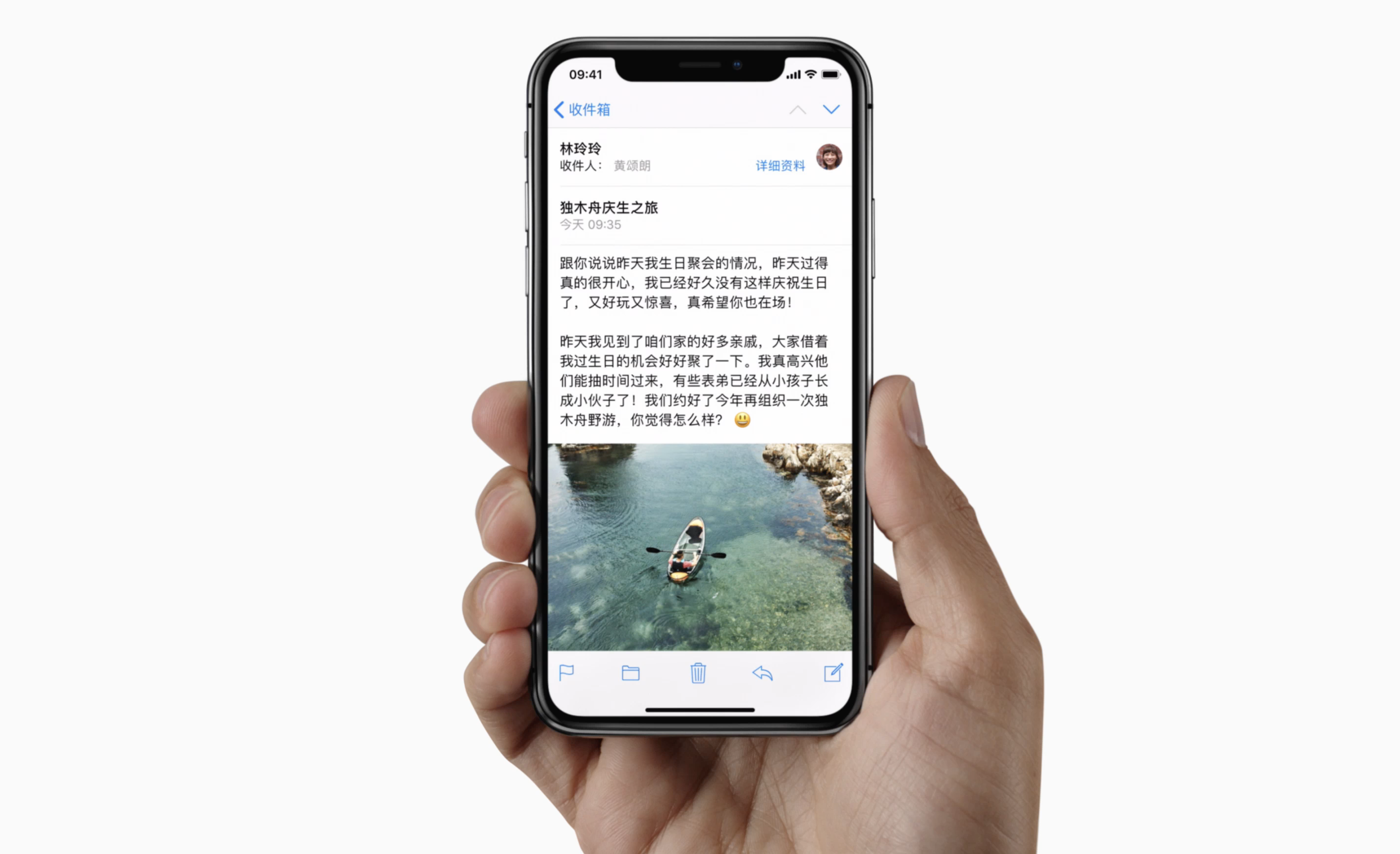 Person reading an email in Chinese on an iPhone X