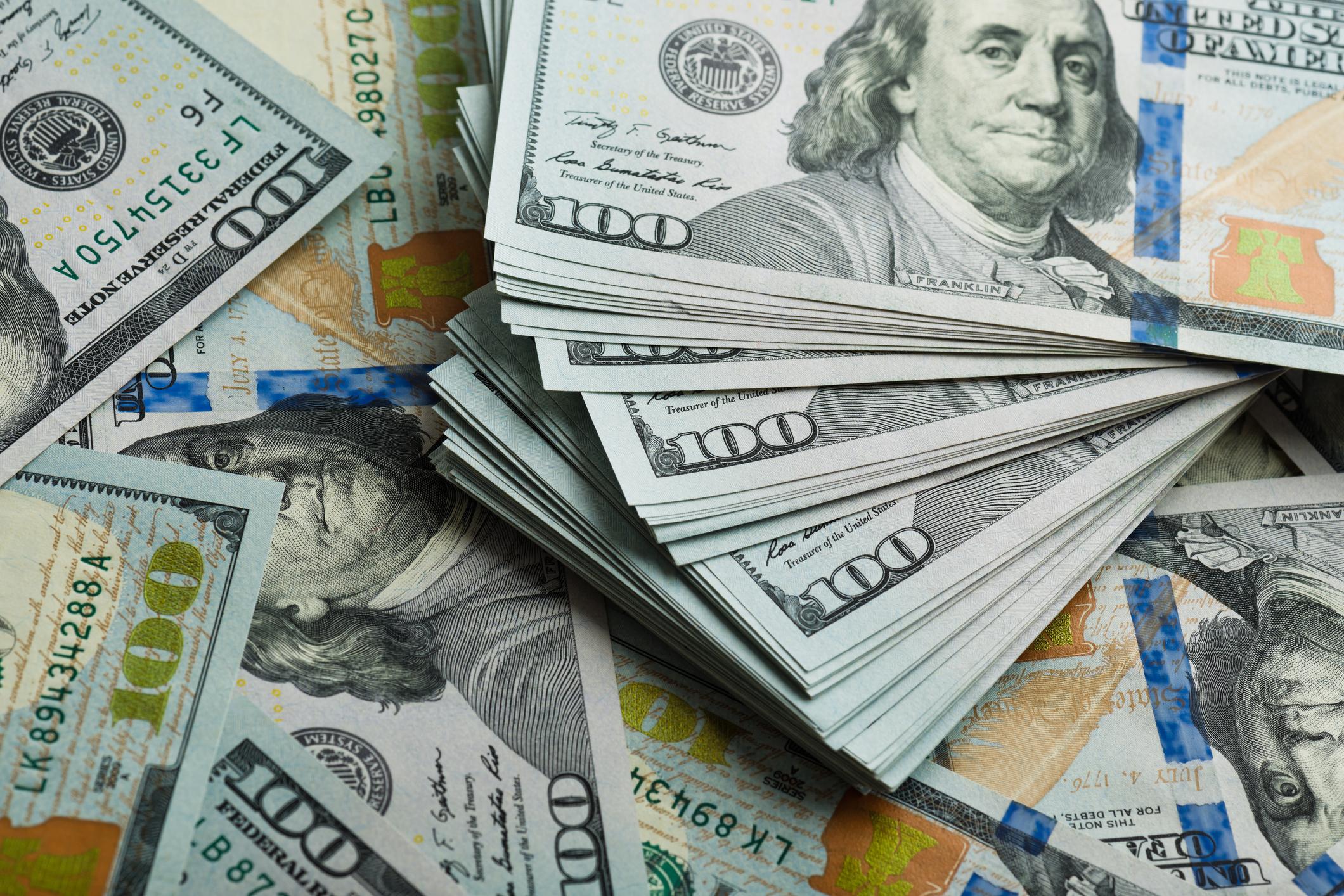 large pile of hundred dollar bills