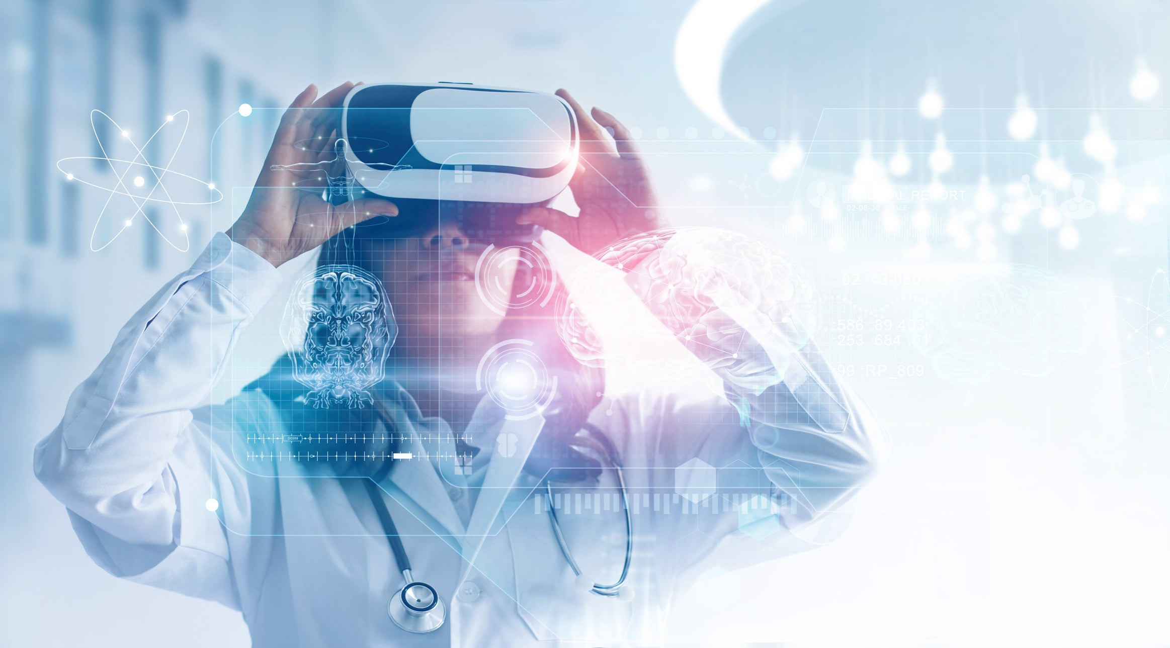 Person in a white lab coat and stethoscope, wearing a VR headset