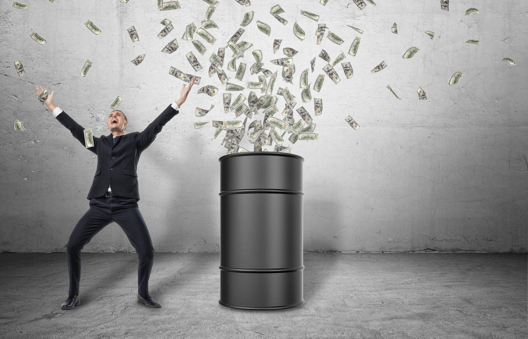 A barrel on a gray floor with money bursting out of it, with a happy businessman celebrating next to it