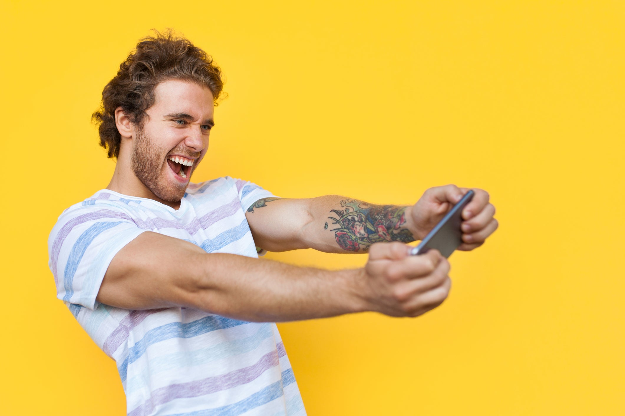 A man plays a smartphone game.