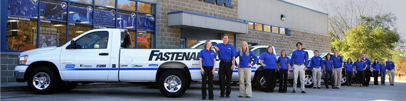 Fastenal employees standing in front of a company truck and store location