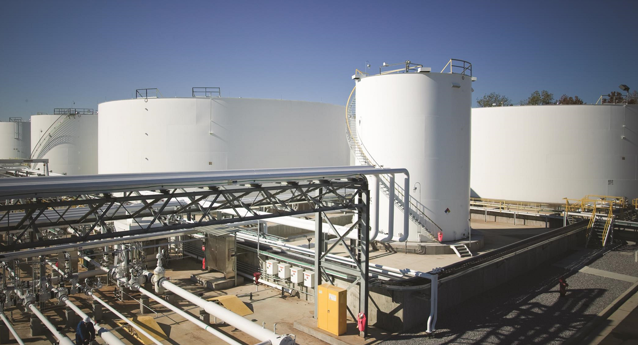Oil storage tanks and pipelines at a network facility.