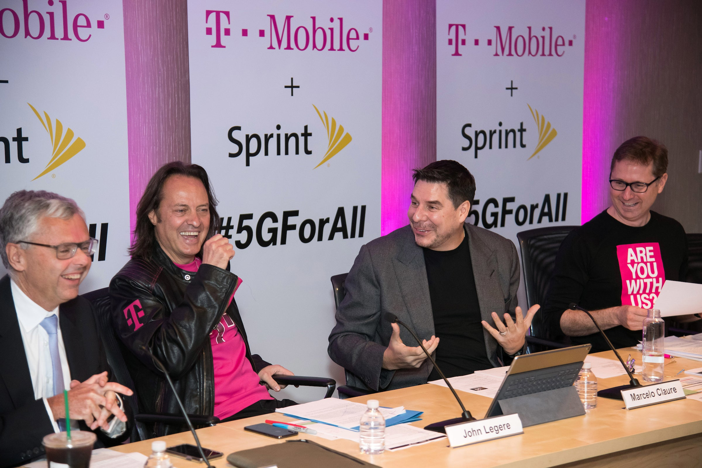 Sprint and T-Mobile executives hosting a conference call to discuss the deal
