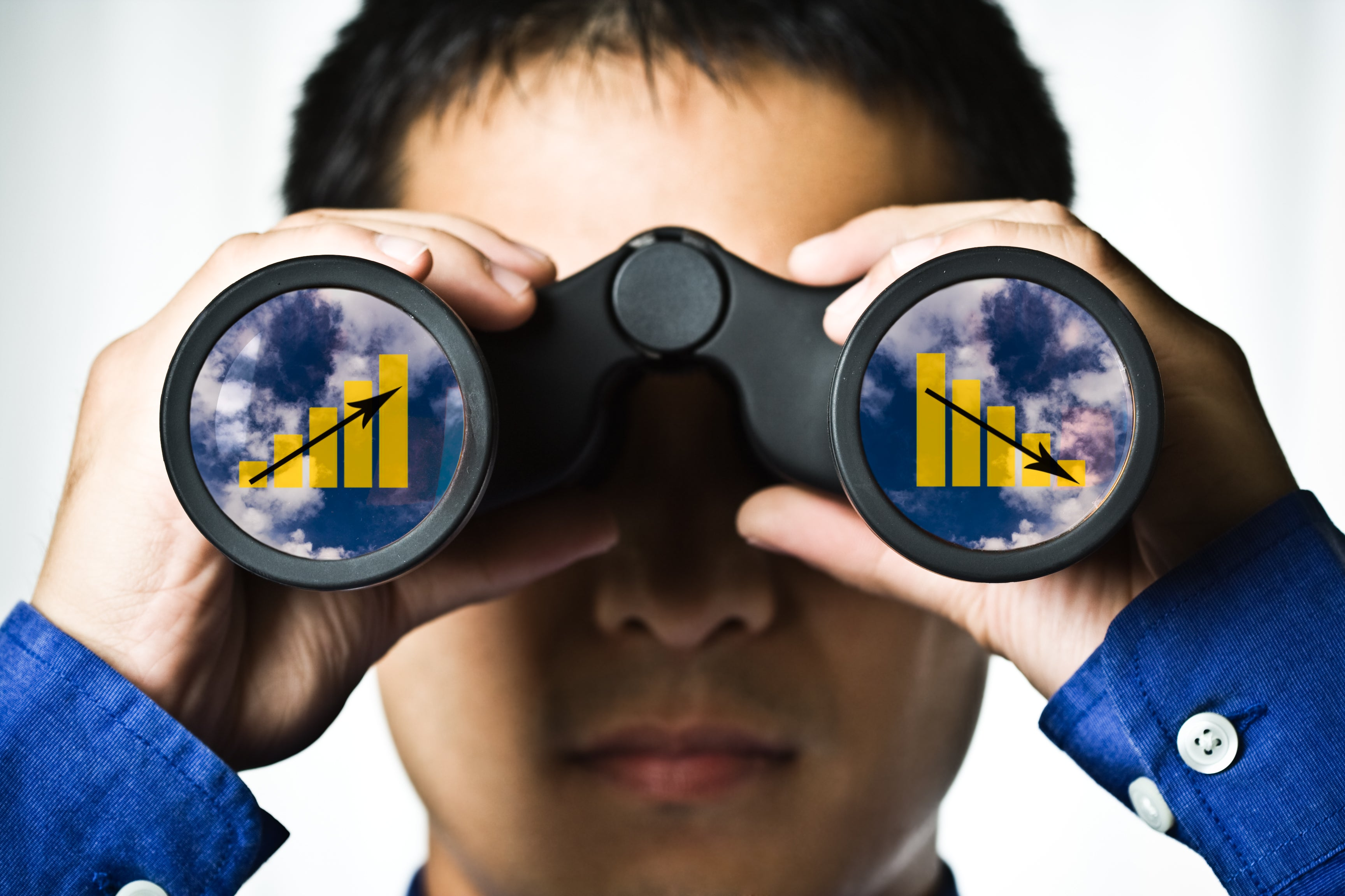 Man looking through binoculars with charts appearing in both lenses