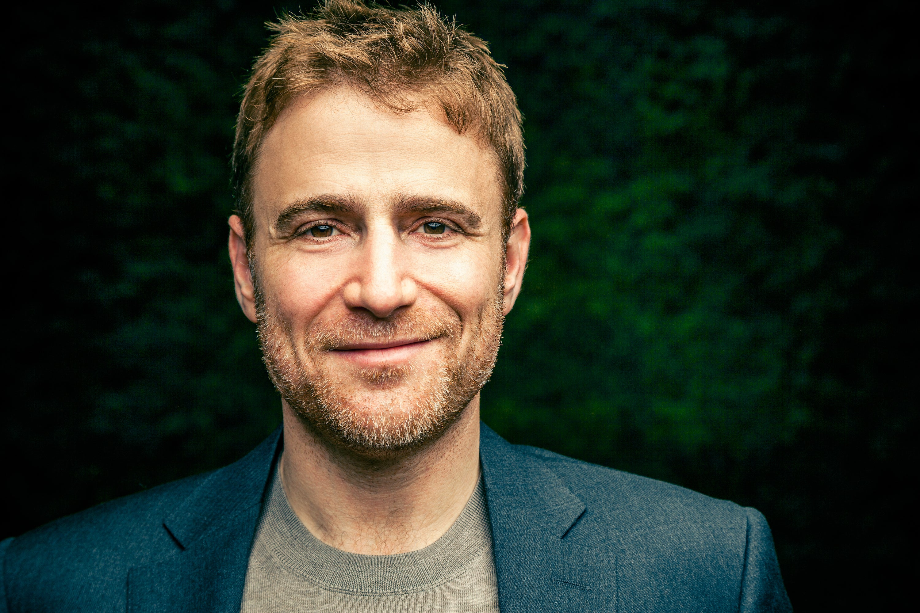 Stewart Butterfield with some greenery in the background