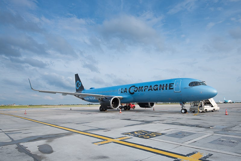 A La Compagnie Airbus A321neo parked on the tarmac