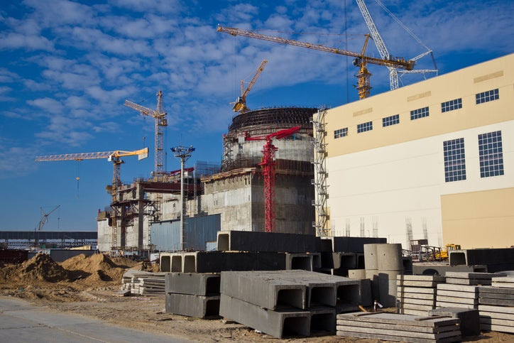 The construction of a large-scale nuclear power plant.