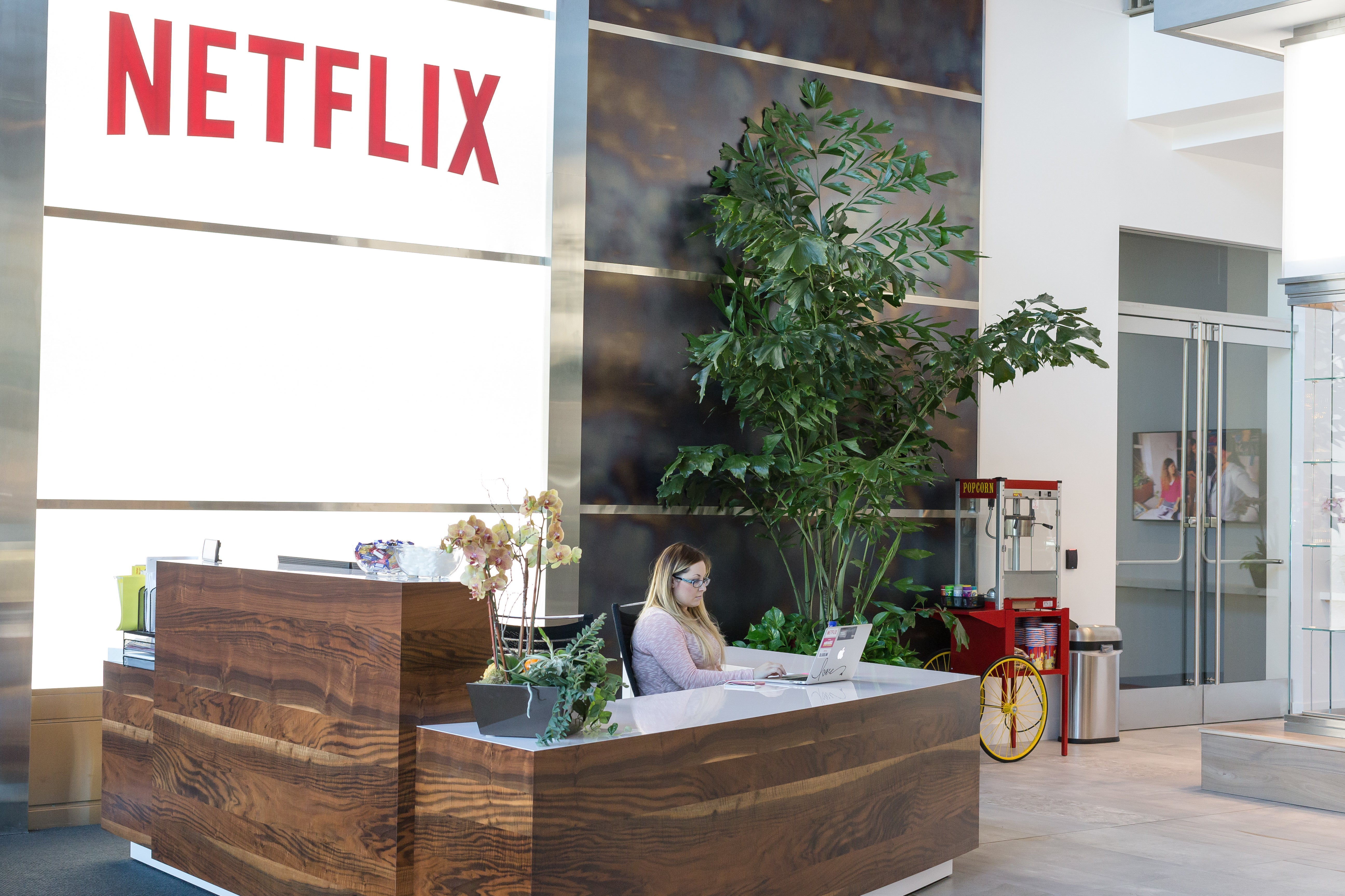 A receptionist sitting at a desk in the Netflix headquarters.