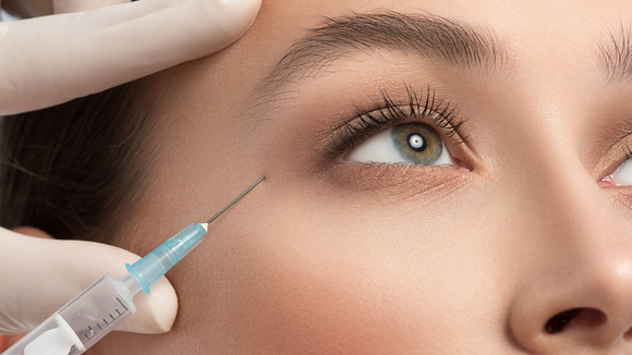A patient receives a Botox injection.
