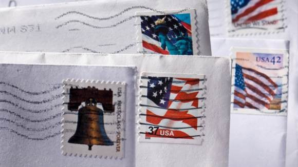 Canceled stamps on the corners of envelopes.