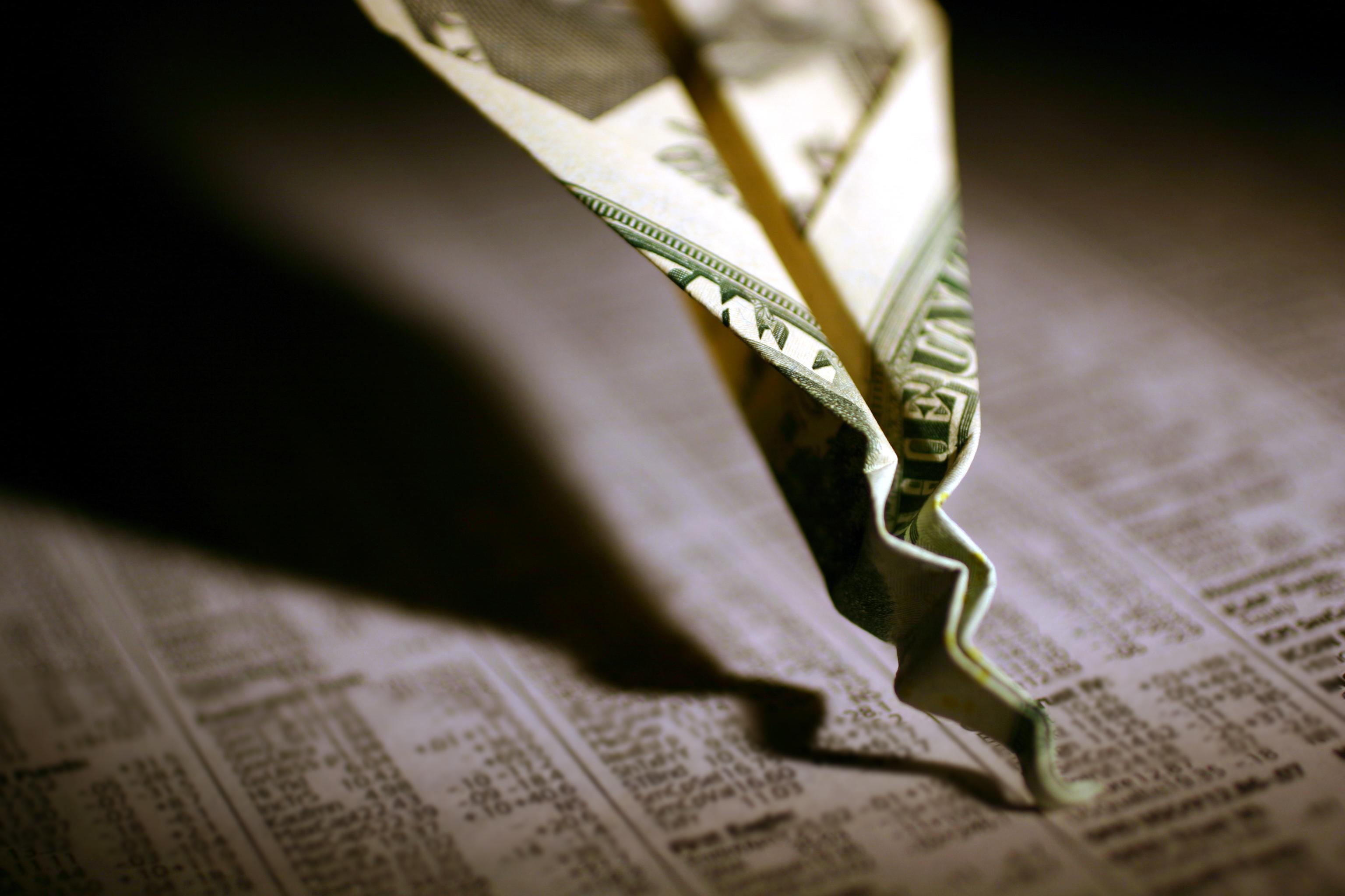stock market crash plunge dollar newspaper invest dow sp 500 getty.'