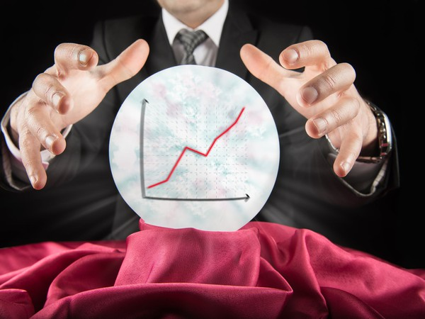 GETTY Fortune teller businessman sees rising market in a crystal ball