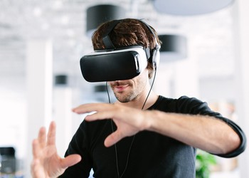 man using virtual reality headset VR