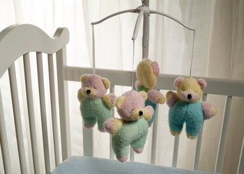 Baby crib with stuffed bears