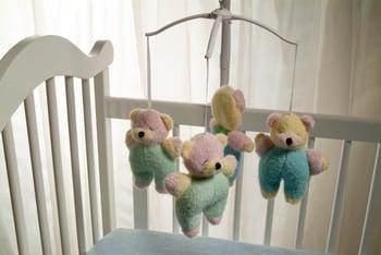 Baby crib with stuffed bears
