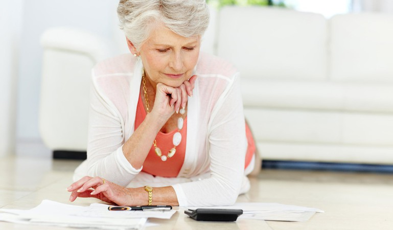 senior woman reviewing her budget_GettyImages-171247302