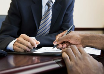signing paperwork bank mortgage contract 1500