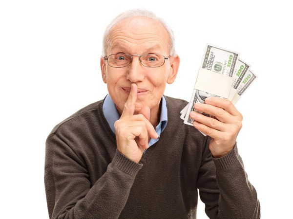 Senior Man Holding Money Keeping Secret Shushing Getty