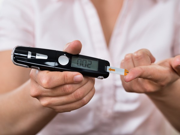 Woman With Glucometer Diabetes Testing Blood Getty