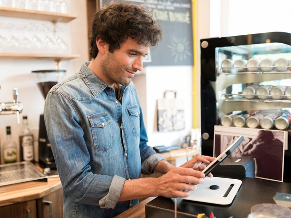 Restaurant Technology Man Using Tablet in Cafe