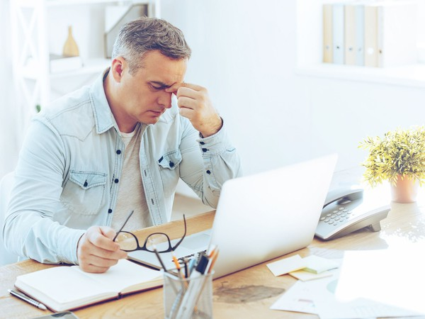 mature man frustrated upset sitting in front of computer