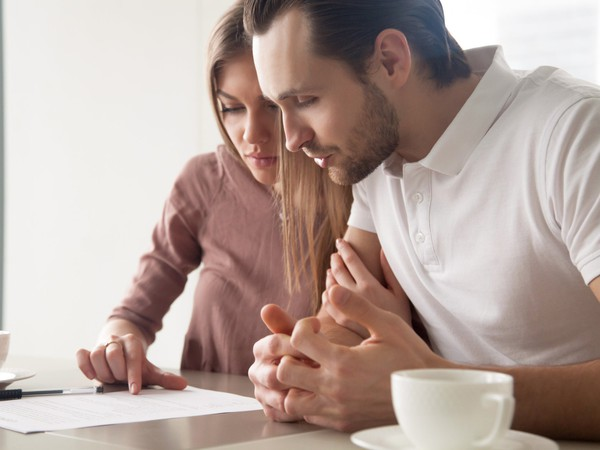 young couple worried about bills_GettyImages-680437082