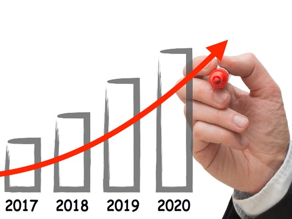 Concept of business man drawing growth chart for the year 2020.