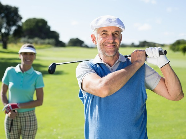 17_07_18 Husban and wife playing golf_GettyImages-692081092