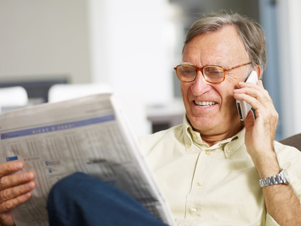 senior male reading newspaper_GettyImages-105942422