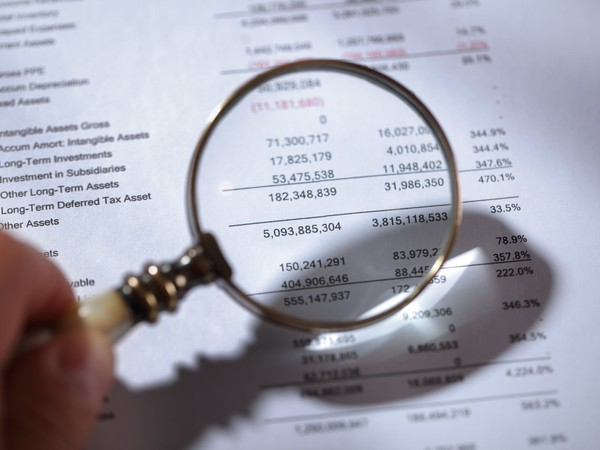 Financial_Statement_With_Magnifying_Glass