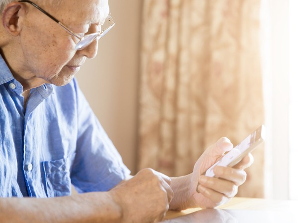 older man on phone_GettyImages-583734508
