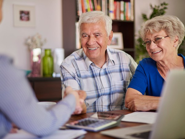 Retired couple talking with professional